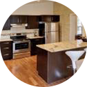 Kitchen with Stainless steel appliances, kitchen island and new kitchen cabinets